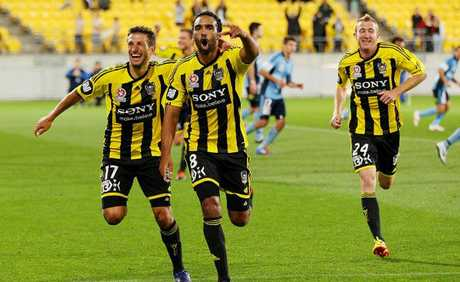 Paul Ifill and Vince Lia of the Phoenix celebrate the winning goal during the A-League Elimination Final match between the Wellington Phoenix and Sydney FC