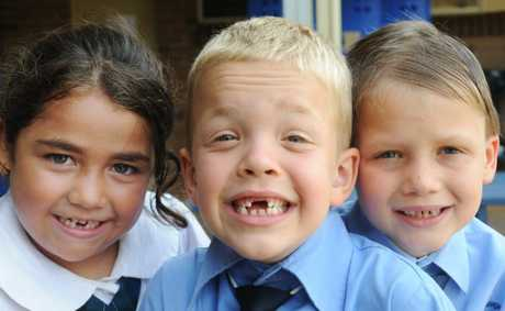 Proud of and showing off their healthy baby teeth are from left Blue Hills College year 1 students from left Talani Smith,6, Noah Allen,7 and Maxwell Contojohn,7. Photo Jacklyn Wagner / The Northern Star