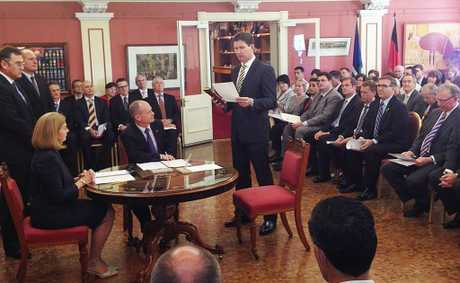 Lawrence Springborg is sworn in as the new State Government's Minister of Health.