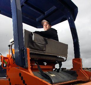 HARD GRAFT: Napier Technical's Angus Benson on the job as a roller operator for Dudding Contractors.