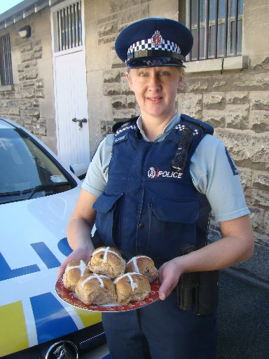 TASTY IDEA: Constable Liesbeth Wouters will be one of the officers handing out hot cross buns at a police checkpoint today.PHOTO/JONATHAN CHILTON-TOWLE
