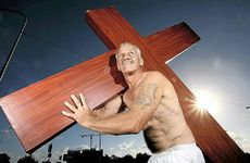 CROSSED PATHS: John Van De Leur carries a cross to spread and celebrate his faith.