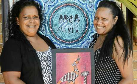 Artists Elsie and Mini Randall of Yamba with a selection of the many beautiful artworks for sale during the Yaegl Country Aboriginal Art Exhibition.