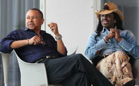 DEVOTION: Earth, Wind & Fire's Ralph Johnson and Verdine White take note of a fan waving out to them during an interview at the Sebel Trinity Wharf Hotel prior to their gig at the National Jazz Festival.