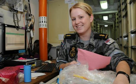 Able Seaman Lisa Thompson putting stock away on board HMAS Melbourne in the Gulf of Aden as part of Operation Slipper.