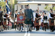 Clan chieftain Peter Smith leads the 108th Maclean Highland Gathering mass band march through Maclean's CBD.