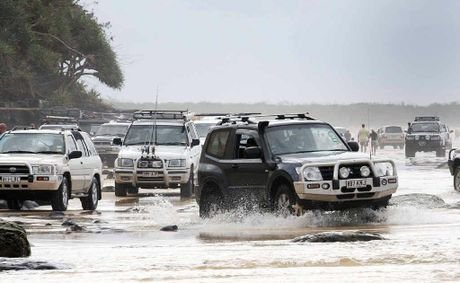 BUSY: Four-wheel drives take on the Mudlo Rocks this Easter at Rainbow Beach.