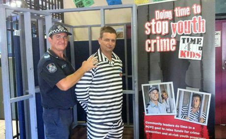 PCYC branch manager Sergeant Greg Jones throws community leader Andrew Prince from Youth Justice behind bars.