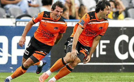 Roar midfielder Thomas Broich celebrates after scoring his teams first goal.