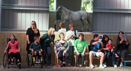 Some of the RDA riders, parents and carers who attended the official opening of the new arena. 