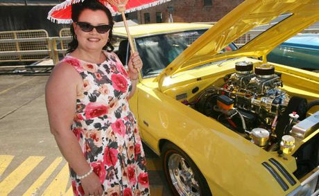 Rachel Azzopardi checks out a 1970 VG Coupe at the Chrysler Show and Shine.