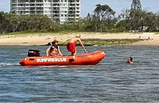 A swimmer is rescued from Maroochy River mouth.