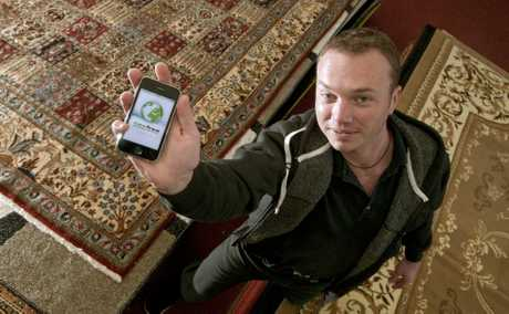 Ben Kitley shows one of the many apps you can use for geocaching around Toowoomba.