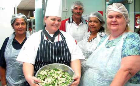 EATING WELL: Cook for Life trainee Meryleen Renouf with TAFE chef Carmen Crain and classmates Lindsay Bayles, Patsy Klass and Linda McDonald.