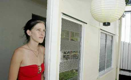 Amy Rann at the house she is renting in Mt Morgan that she claims is dangerous to live in.
