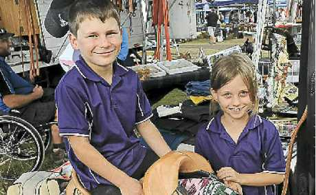 Cody and Cassie Lentas test ride Burrum River Saddlerys products at the AgroTrend field day.