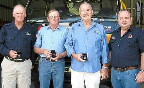 Award recipients Ron Follett, Bill Janke and David Barsley with Widgee Rural Fire Brigade president Rob Lonergan.