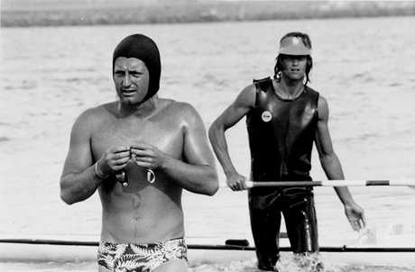 John Coutts (left) prepares for another of his marathon swims when he was at his prime.