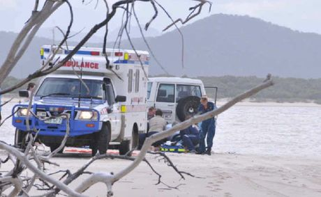 BEACH INCIDENT: Queensland Ambulance Service paramedics performing CPR on a 42-year-old woman who drowned yesterday at Farnborough Beach, north of Yeppoon.