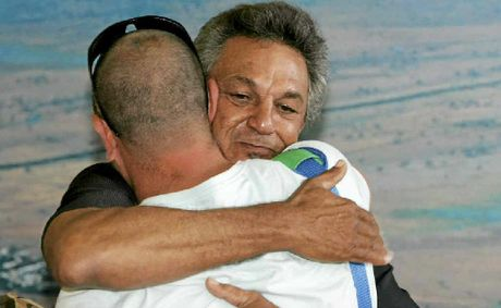 After 36 years Ron Richards embraces his son, Steve, for the first time.