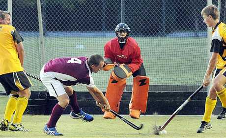 Hervey Bay's James Manson has the Granville defence hopping as he takes a shot on goal in the Premier League hockey match.