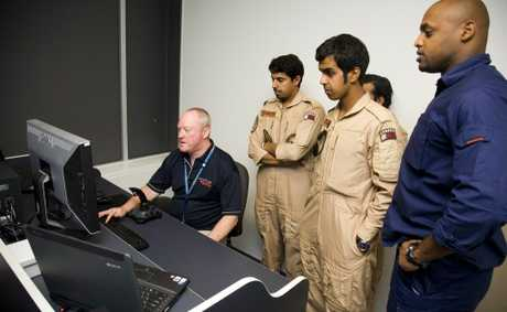 Instructor Steve Jones shows Ali, Mansour and Hamad from the Qatar Emiri Air Force a thing or two.