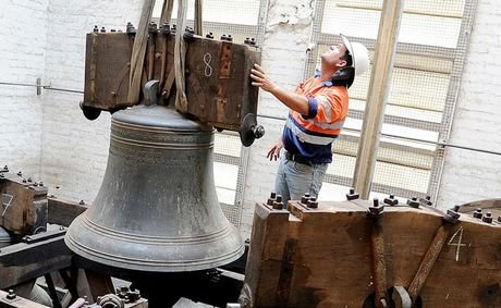 UP AND AWAY: A team of workers used a crane to remove the 125-year-old bells from St Pauls Anglican Church so they could be sent for repair in England.