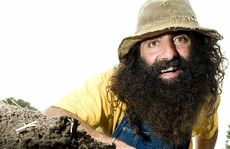 Costa Georgiadis from ABC TV's Gardening Australia digs up some fresh soil at the Felton Food Festival.