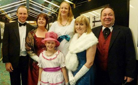 Debbie and Damian Foale, Nisha Van Wyk and her daughter Mikaila Van Wyk (front centre), Jocelyn and Don Watts dressed up in Edwardian finery to mark the Titanic tragedy.
