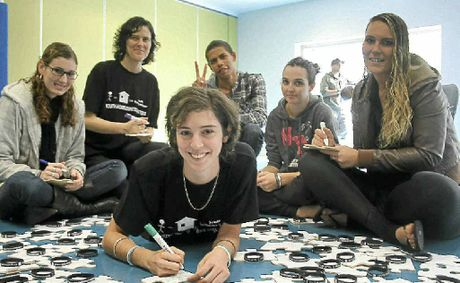 Creating a giant jigsaw puzzle with solutions to ending youth homelessness are: Meaghan Vosz, Nicola Prosser, Sarah Bennett, Lincoln Knight, Lauren Magri and Kiya Lee.