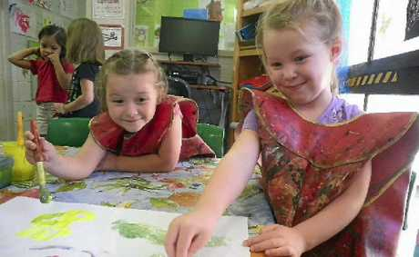 Lilly Gahan, 4, and Sienna Maitland, 4, from Stepping Stones Kookas are painting a picture for Zaac.