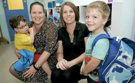 Rockhampton's Raelene Ensby, with her children Tyler (2) and Caleb (4), and Katrina Svensen are set to send their kids to school after taking part in The Smith Family's Saver Plus program.