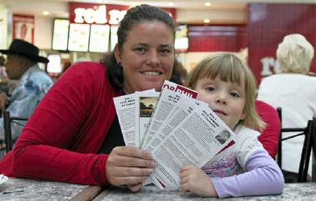 Sandra Ellis and four-year-old daughter Jessica assess their councillor and mayoral candidate options.