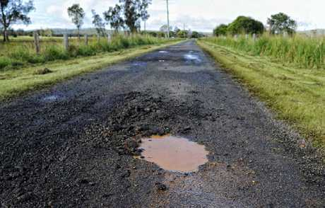 Pot holes in the road on Calligans Creek Road, Calliope.
