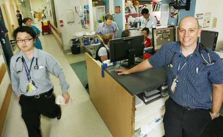Emergency Department executive director Dr Dan Bitmead (right) in the busy Ipswich Hospital Emergency Department. 