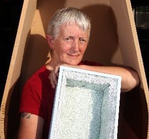 MADE WITH LOVE: Coffin Club member Chris Mills holding one of the smaller coffins they are making for premature babies.