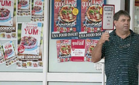"South St Newsagency owner Robert ""Rowdy"" Reid talks to police after his business was robbed on Wednesday, January 18."