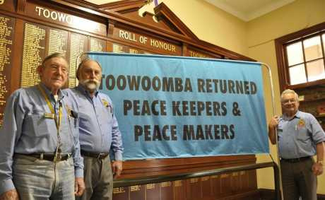 Presenting the new Toowoomba returned peacekeepers banner are (from left) Toowoomba RSL sub-branch committee member Joe Treers, secretary Ed Beningfield and president Lindsay Morrison.
