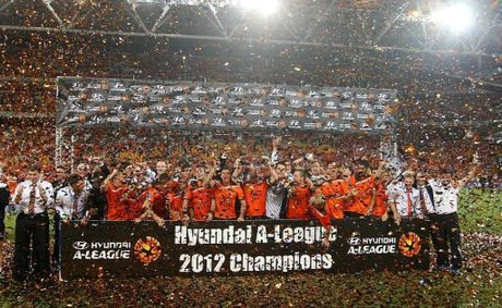 Brisbane Roar players celebrate after winning the A-League grand final at Suncorp Stadium.