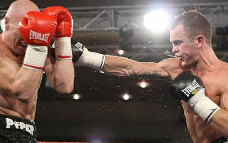 Jarrod Fletcher lands a straight right on Les Piper during his Australian middleweight title fight in Melbourne.
