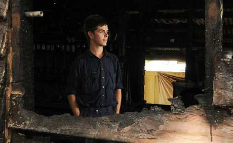 GONE: Dylan Morrissey inside his friends home that was gutted by fire on Sunday morning.