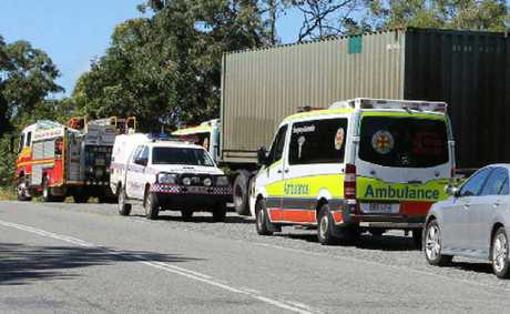 Emergency services vehicles lined Shute Harbour Rd yesterday afternoon as crews descended rough terrain close to the port to retrieve a 51-year-old man's body.