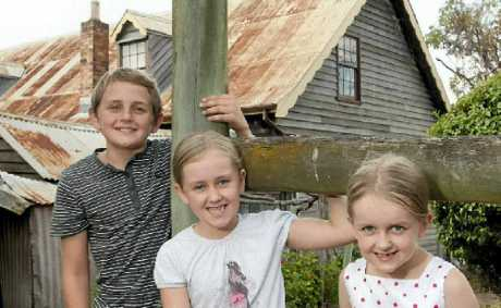 Exploring at the reopening of the Royal Bull's Head Inn are (from left) Jacob, Ella and Lily Zupp.