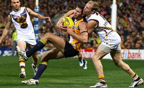 Jack Darling of the Eagles marks the ball against Michael Osborne of the Hawks during the round four AFL match between the West Coast Eagles and the Hawthorn Hawks at Patersons Stadium.