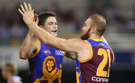 Tom Crisp and Daniel Merrett of the Lions celebrate after a goal during the round four AFL match between the Brisbane Lions and the Gold Coast Suns at The Gabba.