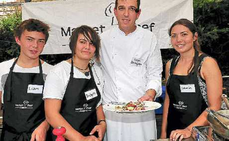 Heat winners Liam, Bridgette and Laurin Waller with chef Leigh Darlington at Eumundi markets.