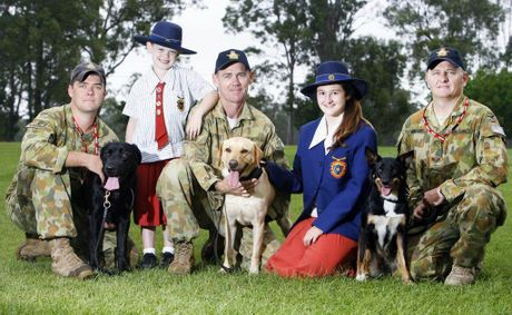 RAAf Base Amberley Explosive Detection Dogs Zac, Lucy and Esky (l-r) pose with their handlers Sgt David Skeels, LAC Patrick Yeates and Cpl Heath Webber and West Mac students Rosie Yeates, 6, and Skye Webber, 14.