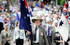 Second World War veteran Sid Goldfinch marches in the Anzac Day parade in Mary St yesterday.