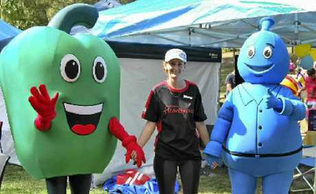 Organiser Megan Rodi with Cheryl the Capsicum and Eric (swap it) at last year's Healthy Lifestyle Expo at Seventeen Seventy.