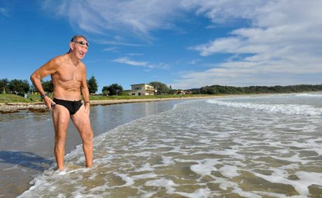 Bruce Bredner in a familiar pose on Woolgoolga Beach 